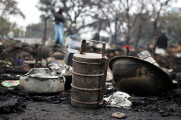 Kitchen utensils are pictured after a fire broke out in a slum area in Jammu