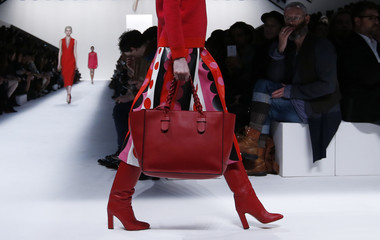 A model presents a hand bag creation by Italian designers Maria Grazia Chiuri and Pier Paolo Piccioli as part of their Fall/Winter 2014-2015 women's ready-to-wear collection for house Valentino during Paris Fashion Week