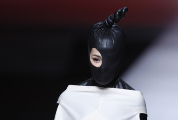 A model presents a creation during China Fashion Week in Beijing