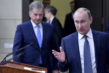 Russian President Putin and his Finnish counterpart Niinisto arrive for joint news conference following their talks at Novo-Ogaryovo state residence outside Moscow