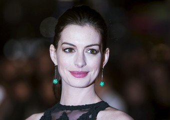 "U.S. actress Anne Hathaway poses for photographers at the European premiere of her film ""The Intern"" in London, Britain"