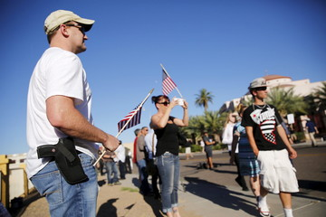 """A demonstrator with hand gun attends """"Freedom of Speech Rally Round II"""" across street from Islamic Community Center in Phoenix"""