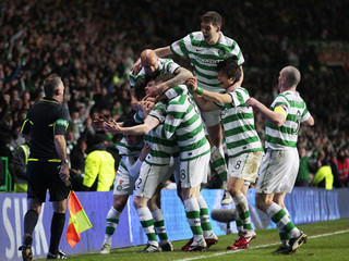 Team mates of Celtic's Wilson celebrates with teammates after scoring against Rangers during their Scottish Cup soccer match in Glasgow
