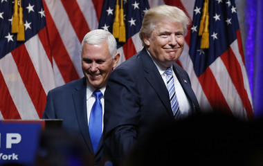 Republican U.S. presidential candidate Trump steps away after greeting Indiana Governor Pence during the introduction of Pence as his vice presidential running mate in New York