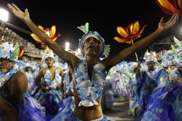 Revellers from the Portela samba school parade on the first night of the annual Carnival parade in Rio de Janeiro's Sambadrome