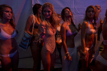 Models prepare to walk on stage during Frankie's Bikinis show in the backstage area at Mercedes Benz Swim Fashion Week in Miami