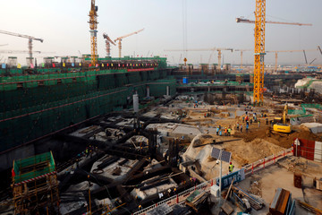 Workers labour at the construction site of the terminal for the Beijing New Airport in Beijing