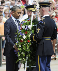 Obama inspects a Memorial Day wreath at the Tomb of the Unknowns at Arlington Cemetery in Arlington, Virginia