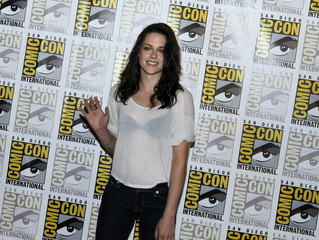 """Actress Kristen Stewart poses to promote """"Breaking Dawn"""" from the Twilight Saga at Comic Con in San Diego"""