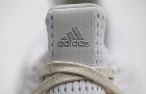 Adidas logo is pictured at 3D printed plastic shoe before news conference in Herzogenaurach