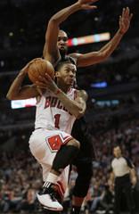 Chicago Bulls Derrick Rose shoots on the San Antonio Spurs Tim Duncan in Chicago