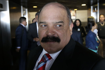 Venezuela's Central Bank President Nelson Merentes leaves a news conference in Caracas