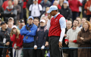 U.S. Ryder Cup player Tiger Woods reacts after missing a putt on the third day of the 2010 Ryder Cup at Celtic Manor in Newport, south Wales