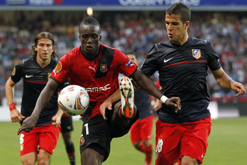 Montano of Stade Rennes challenges Dominguez of Atletico Madrid during their Europa League soccer match in Rennes