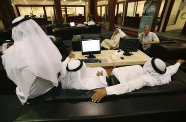 Investors work on the trading floor at the Dubai International Financial Market