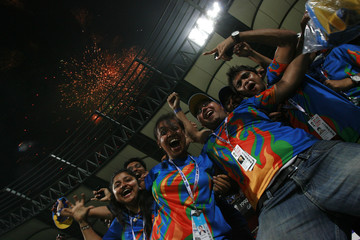 Fans celebrate after India beat Sri Lanka in the ICC Cricket World Cup final match in Mumbai