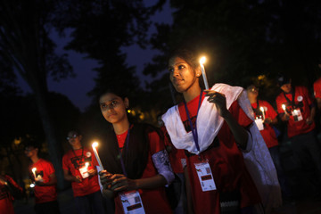 Activists attend a candle light vigil on World Food Day in Dhaka