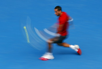 Feliciano Lopez of Spain hits a return to Andy Murray of Britain during their men's singles match at the Australian Open 2014 tennis tournament in Melbourne