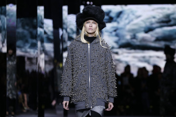 A model presents a creation by Italian designer Giambattista Valli from his Fall/Winter 2014-2015 women's ready-to-wear collection for fashion house Moncler Gamme Rouge during Paris Fashion Week