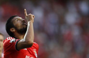 Benfica's Garay celebrate his goal against Pacos Ferreira during their Portuguese Premier League match in Lisbon
