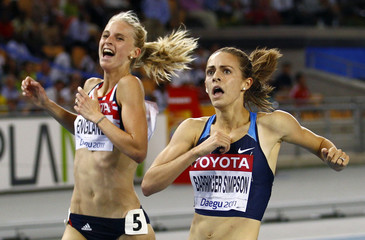 Jennifer Barringer Simpson of the U.S. celebrates winning the women's 1500 metres final next to Hannah England of Britain in Daegu