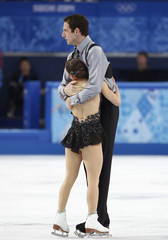 Marissa Castelli and Simon Shnapir of the U.S. celebrate during the Figure Skating Pairs Free Skating Program at the Sochi 2014 Winter Olympics
