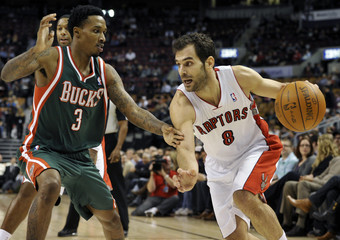 Raptors guard Jose Calderon goes to the basket against Bucks guard Brandon Jennings during their NBA basketball game in Toronto