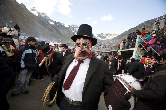 "An Andean dancer wearing a mask performs during celebrations in honor of the Lord of ""Qoyllur Rit'i"" at the Sinakara Valley in Cuzco"