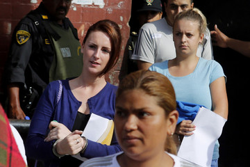 Michaella McCollum Connolly and Melissa Reid leave the court at Sarita Colonia prison in Callao