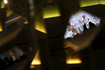 Clinton is reflected in a mirrored wall as she takes part in an onstage interview with Lee at the BET Networks Leading Women Defined program in Bal Harbour, Florida
