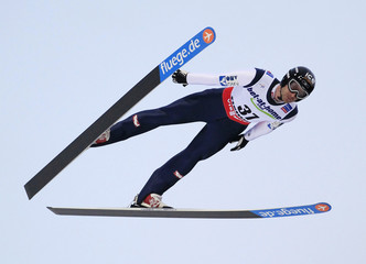 Loitzl of Austria soars through the air during the Large Hill Individual jumping competition at the FIS Nordic Skiing World championships in  Val di Fiemme