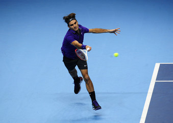 Switzerland's Federer returns a shot during his men's singles tennis match against Spain's Ferrer at the World Tour Finals in London