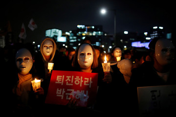 People march toward the Presidential Blue House during a rally calling for President Park Geun-hye to step down in central Seoul