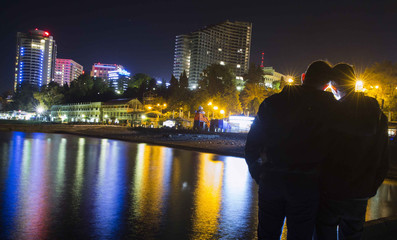 Gay rights activist Slavsky poses for a photograph with his boyfriend, who wants to remain anonymous, at the Black Sea promenade in Sochi