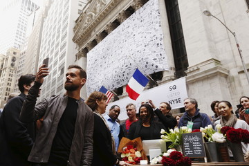 Jack Dorsey , CEO of Square and CEO of Twitter, live casts video while standing outside the New York Stock Exchange for the IPO of Square Inc., in New York