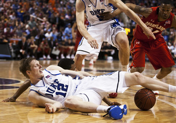 Devils forward Kyle Singler works for a loose ball against the Terrapins during their NCAA men's basketball game at the 2011 ACC Tournament in Greensboro