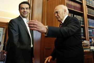 Greek President Karolos Papoulias welcomes leader of the Left Coalition party Alexis Tsipras in his office in Athens