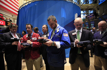 Traders await the IPO for Gazit-Globe Ltd on the floor of the New York Stock Exchange