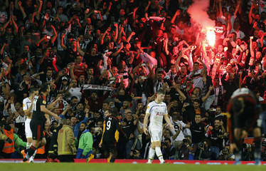 Besiktas' Ba celebrates in front of supporters after scoring a penalty shot during their Europa League Group C soccer match against Tottenham Hotspur at White Hart Lane in London