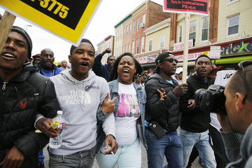 Protesters march during a rally to protest the death of Freddie Gray who died following an arrest in Baltimore