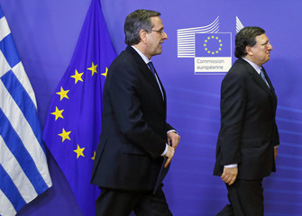 Greece's Prime Minister Samaras is welcomed by European Commission President Barroso before their meeting at the EU Commission headquarters in Brussels