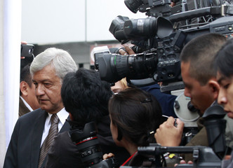 Lopez Obrador, presidential candidate for the PRD, arrives at a polling station to cast his vote in Mexico