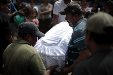 People carry coffin of three-month-old baby from Gonzalez family who was shot dead during attack by unknown assailants in Las Escobas village in Villacanales