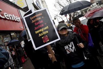 Fast-food workers and their supporters join a nationwide protest for higher wages and union rights outside McDonald's in New York
