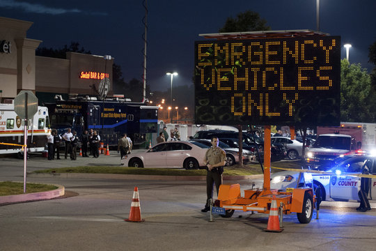 Police use a large mall parking lot as a staging area and command post for addressing protests over the shooting death of Michael Brown, in Ferguson