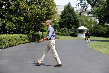 U.S. President Barack Obama arrives from Camp David aboard Marine One on the South Lawn at the White House in Washington