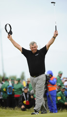 Darren Clarke of Northern Ireland celebrates on the 18th green after winning the British Open golf championship at Royal St George's in Sandwich