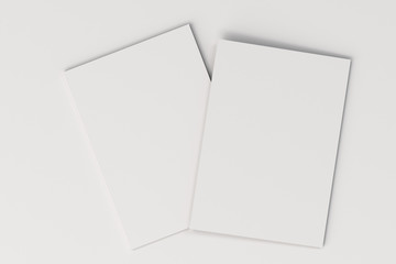 Two blank white closed brochure mock-up on white background