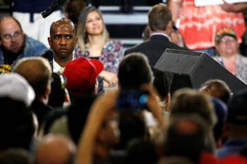 A Secret Service agent scans the crowd as Trump holds a rally with supporters in Albuquerque