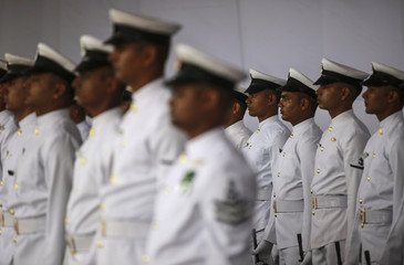 Indian navy personnel wait for the arrival of Indian Prime Minister Narendra Modi for the commissioning ceremony of the warship INS Kolkata at a naval base in Mumbai